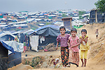 Rohingya children walk though the sprawling Kutupalong Refugee Camp near Cox's Bazar, Bangladesh. More than 600,000 Rohingya refugees have fled government-sanctioned violence in Myanmar for safety in this and other camps in Bangladesh.