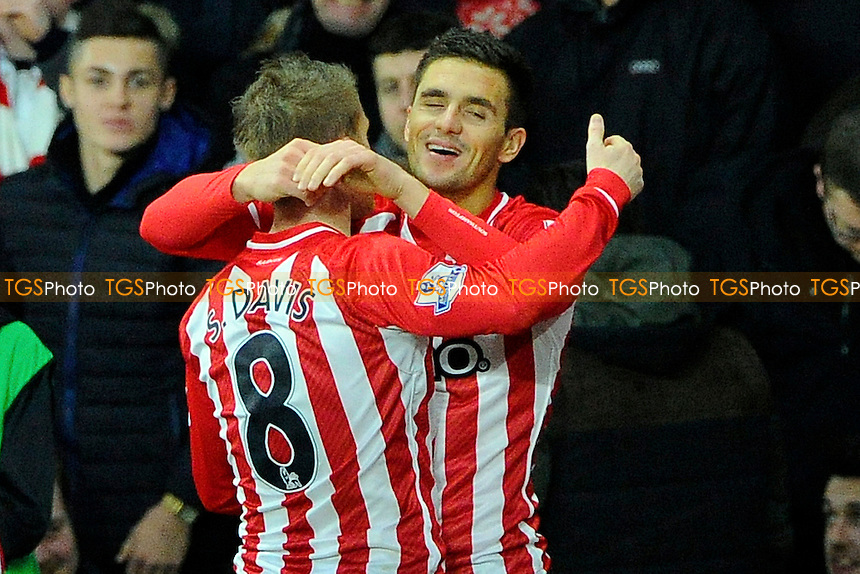 Dusan Tadic of Southampton right celebrates his goal with Steven Davis of Southampton - Southampton vs Arsenal - Barclays Premier League Football at St Mary's Stadium, Southampton, Hampshire - 01/01/15 - MANDATORY CREDIT: Denis Murphy/TGSPHOTO - Self billing applies where appropriate - contact@tgsphoto.co.uk - NO UNPAID USE