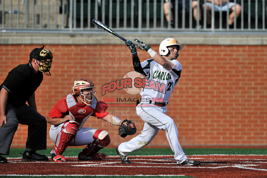 Center fielder Reece Hampton (2) of the Charlotte 49ers hits in a game against the Fairfield Stags on Saturday, March 12, 2016, at Hayes Stadium in Charlotte, North Carolina. The Stags catcher is Kevin Radziewicz and the home plate umpire is Darin Tyson. (Tom Priddy/Four Seam Images)