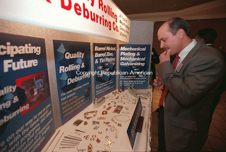 SOUTHINGTON, CT 10/13/98--1013CA05.tif  David Giapponi from Thomaston who works with Theis Prescion Steel in Bristol, examines the selection on display by Quality Rolling & Deburring located in Thomaston. David Giapponi says he enjoys looking at the selection of products produced in Connecticut. The manufacturing alliance of Connecticut annual meeting was held at the Aqua Turf Club in Southington, on Tuesday evening.  --CRAIG AMBROSIO staff  / STAND ALONE PHOTO  (Filed in Scans/Scan-In)