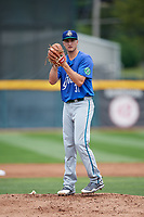 Hartford Yard Goats starting pitcher Ryan Castellani (31) gets ready to deliver a pitch during a game against the Erie SeaWolves on August 6, 2017 at UPMC Park in Erie, Pennsylvania.  Erie defeated Hartford 9-5.  (Mike Janes/Four Seam Images)