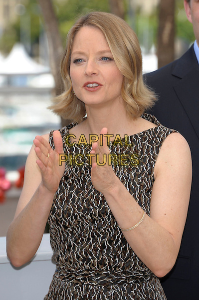 JODIE FOSTER.'The Beaver' photocall at the Palais des Festival, 64th International Cannes Film Festival, France.17th May 2011.half length dress brown beige print sleeveless hands mouth open.CAP/PL.©Phil Loftus/Capital Pictures.