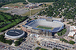 "15 August 2008: Aerial view of Michigan Stadium undergoing major renovations and expansion in Ann Arbor, MI. The three year, $226 million project will add 82 luxury suites, a new press box, improved stadium seating and concourse fans amenities, as well as premium club seating sections that will eventually bring the ""Big House"" capacity to over 108,000. Project completion is scheduled for August 2010. Adjacent to the stadium is Crisler Arena, Michigan's basketball venue."