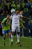 Leo Gonzales (l) and Alvaro Fernandez (r) of the Seattle Sounders defend against Jovan Kirovski(c) of the Los Angeles Galaxy in the first game of the 2010 MLS Playoffs at the XBox 360 Pitch at Quest Field in Seattle, WA on October 31, 2010. The Galaxy defeated the Sounders 1-0.