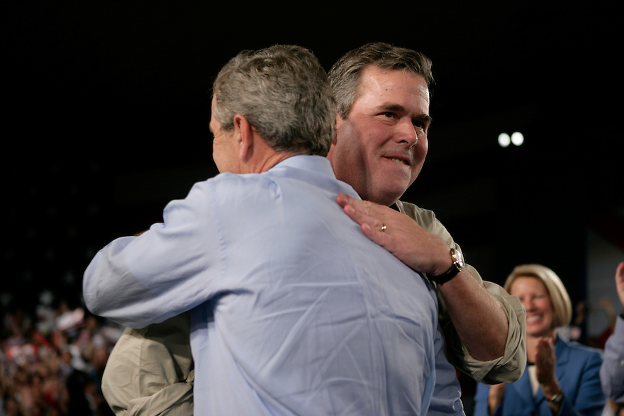 U.S. President George W. Bush and his brother Florida Governor Jeb Bush to attend a campaign election rally in Miami, Florida.