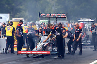 Aug. 18, 2013; Brainerd, MN, USA: Crew members for NHRA top fuel dragster driver Steve Torrence during the Lucas Oil Nationals at Brainerd International Raceway. Mandatory Credit: Mark J. Rebilas-