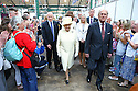 Local people clap as Britain's Queen Elizabeth II and the Duke of Edinburgh tours St.Georges Market in Belfast, Tuesday June 24th, 2014. The Queen is on a 3 day tour of Northern Ireland. Photo/Paul McErlane