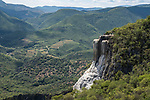 Cascada Grande or the Big Waterfall mineral formation at Hierve el Agua, near Mitla, Mexico.  Behind are the Sierra Madre del Sur Mountains.
