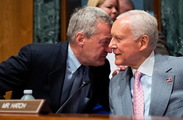 """UNITED STATES - JUNE 12:  Chairman Max Baucus, D-Mont., left, has a word with Sen. Orrin Hatch, R-Utah, before a Senate Finance Committee hearing in Dirksen entitled """"Tax Reform: Impact on U.S. Energy Policy.""""  (Photo By Tom Williams/CQ Roll Call)"""