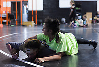 NWA Democrat-Gazette/CHARLIE KAIJO Brissa Bernal, 12, of Bigsby, OK. (top) and Lillian Jones, 15, of Van Buren (bottom) wrestle during a women's wrestling camp, Monday, June 3, 2019 at the Honey Badger Wrestling Club in Bentonville<br />