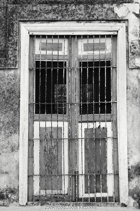 Weathered wooden shutters at Hacienda Yaxcopoil, Yucatan, Mexico