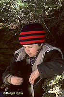 MA01-076z  Black Bear - boy holding cub removed from winter den by wildlife biologists -  Ursus americanus