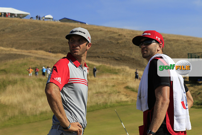Dustin JOHNSON (USA) and caddy Austin at the 9th green during Saturday's Round 3 of the 2015 U.S. Open 115th National Championship held at Chambers Bay, Seattle, Washington, USA. 6/21/2015.<br /> Picture: Golffile | Eoin Clarke<br /> <br /> <br /> <br /> <br /> All photo usage must carry mandatory copyright credit (&copy; Golffile | Eoin Clarke)