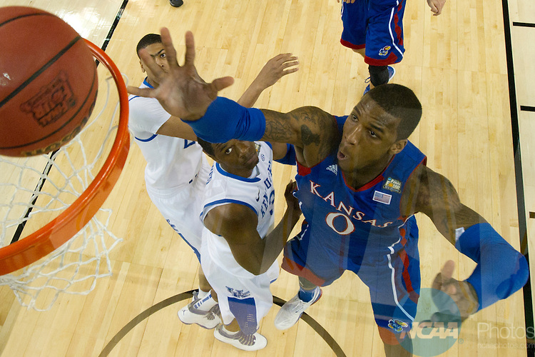 2 APR 2012: Forward Thomas Robinson (0) from the University of Kansas scores a basket during the Championship Game of the 2012 NCAA Men's Division I Basketball Championship Final Four held at the Mercedes-Benz Superdome hosted by Tulane University in New Orleans, LA. Kentucky defeated Kansas 67-59 to claim the championship title. Chris Steppig/ NCAA Photos.