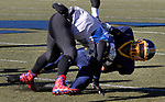 WATERBURY, CT - 23 NOVEMBER 2017 -112317JW04.jpg -- Crosby #23 Shamar Henry is is dragged down by Kennedy #8 Evel Pacheco during the Thanksgiving Day Game at Municipal Stadium.  Jonathan Wilcox Republican-American