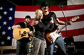 Kandahar, Afghanistan - December 17, 2008 -- Grammy award winning musician Kid Rock, right, American Idol contestant and country musician Kellie Pickler, center, and musician Zack Brown, left, entertain troops stationed at Kandahar, Afghanistan during the 2008 USO Holiday Tour on Wednesday, December 17, 2008. Tour host United States Navy Admiral Mike Mullen, chairman of the Joint Chiefs of Staff, along with his wife Deborah, welcomed comedians John Bowman, Kathleen Madigan and Lewis Black; actress Tichina Arnold on the tour bringing music and entertainment to service members and their families stationed overseas. .Credit: Chad J. McNeeley - DoD via CNP