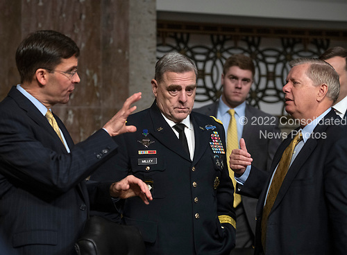 "Mark T. Esper, Secretary of The United States Army, left, US Army General Mark A. Milley, Chief of Staff of The Army, center, and US Senator Lindsey Graham (Republican of South Carolina) share conversation prior to the hearing before the US Senate Committee on Armed Services ""on the posture of the Department of the Army in review of the Defense Authorization Request for Fiscal Year 2019 and the Future Years Defense Program"" on Capitol Hill in Washington, DC on Thursday, April 12, 2018.<br /> Credit: Ron Sachs / CNP"