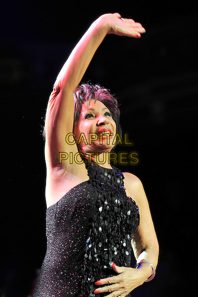 DAME SHIRLEY BASSEY.The Beatles Philharmonic Tribute at the Royal Albert Hall, London, England..October 28th, 2010.stage concert live gig performance music half length black dress paillettes hand arm waving in air saggy skin wrinkles elbow.CAP/MAR.© Martin Harris/Capital Pictures.