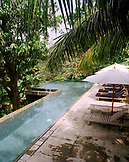 SRI LANKA, Asia, Galle, swimming pool with empty lounge chair at Dutch House Hotel
