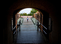 A young explorer walks up the drawbridge connecting the interior of Fort Barrancas to the outer defenses.<br /> <br /> <br /> COLIN HACKLEY PHOTO