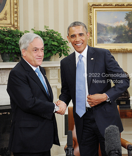 United States President Barack Obama shakes hands with President Sebasti&aacute;n Pi&ntilde;era of Chile in the Oval Office of the White House June 4 , 2013 in Washington, DC. <br /> Credit: Olivier Douliery / Pool via CNP