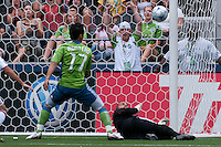 Fredy Montero (17) of the Seattle Sounders just misses scoring a goal over Jon Busch (r) of the Chicago Fire in the match at the XBox Pitch at Quest Field on July 25, 2009. The Sounders and Fire played to a 0-0 draw.
