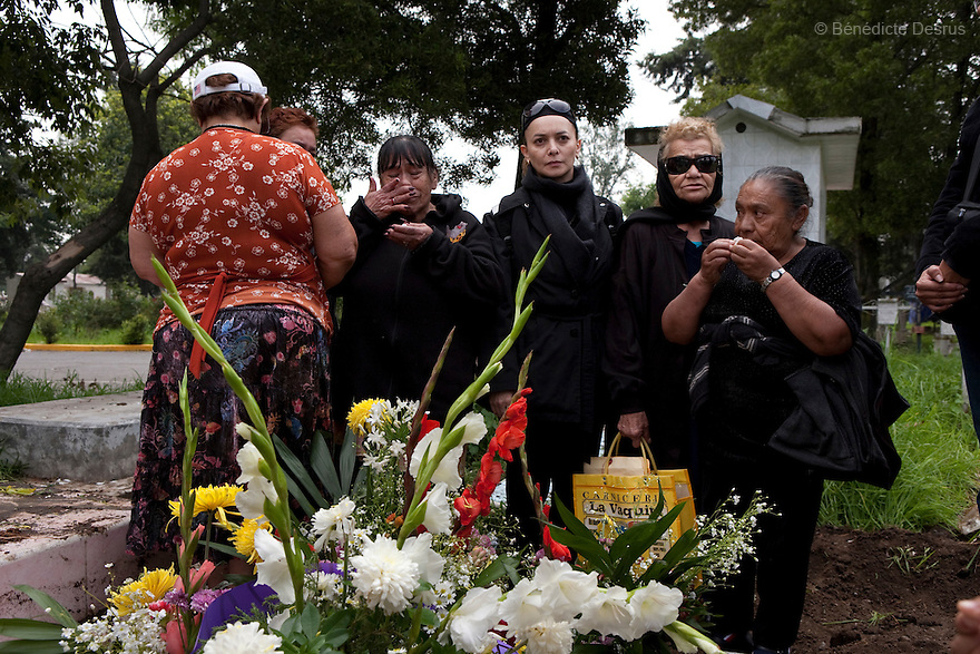 Residents of Casa Xochiquetzal attend the funeral of Delia who died after living at the shelter for one year in Mexico City, Mexico on July 18, 2008. Casa Xochiquetzal is a shelter for elderly sex workers in Mexico City. It gives the women refuge, food, health services, a space to learn about their human rights and courses to help them rediscover their self-confidence and deal with traumatic aspects of their lives. Casa Xochiquetzal provides a space to age with dignity for a group of vulnerable women who are often invisible to society at large. It is the only such shelter existing in Latin America. Photo by Bénédicte Desrus