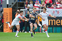 20120803 Copyright onEdition 2012©.Free for editorial use image, please credit: onEdition..Jordan Davies of Sale Sharks looks for a way through Nils Mordt, and Chris Wyles of Saracens  at The Recreation Ground, Bath in the Final round of The J.P. Morgan Asset Management Premiership Rugby 7s Series...The J.P. Morgan Asset Management Premiership Rugby 7s Series kicked off again for the third season on Friday 13th July at The Stoop, Twickenham with Pool B being played at Edgeley Park, Stockport on Friday, 20th July, Pool C at Kingsholm Gloucester on Thursday, 26th July and the Final being played at The Recreation Ground, Bath on Friday 3rd August. The innovative tournament, which involves all 12 Premiership Rugby clubs, offers a fantastic platform for some of the country's finest young athletes to be exposed to the excitement, pressures and skills required to compete at an elite level...The 12 Premiership Rugby clubs are divided into three groups for the tournament, with the winner and runner up of each regional event going through to the Final. There are six games each evening, with each match consisting of two 7 minute halves with a 2 minute break at half time...For additional images please go to: http://www.w-w-i.com/jp_morgan_premiership_sevens/..For press contacts contact: Beth Begg at brandRapport on D: +44 (0)20 7932 5813 M: +44 (0)7900 88231 E: BBegg@brand-rapport.com..If you require a higher resolution image or you have any other onEdition photographic enquiries, please contact onEdition on 0845 900 2 900 or email info@onEdition.com.This image is copyright the onEdition 2012©..This image has been supplied by onEdition and must be credited onEdition. The author is asserting his full Moral rights in relation to the publication of this image. Rights for onward transmission of any image or file is not granted or implied. Changing or deleting Copyright information is illegal as specified in the Copyright, Design and Patents Act 1988. If you are in any way unsure of