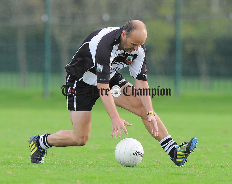 Fergus O Loughlin of Clarecastle in action against  Cratloe during their Junior B county football final in Shannon. Photograph by John Kelly.