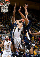 Brandon Smith of California gets sandwiched by UC Irvine defenders during the game at Haas Pavilion in Berkeley, California on November 11th, 2011.  California defeated UC Irvine, 77-56.