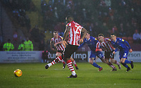 Lincoln City's John Akinde scores his side's second goal from the penalty spot<br /> <br /> Photographer Chris Vaughan/CameraSport<br /> <br /> The EFL Sky Bet League Two - Saturday 15th December 2018 - Lincoln City v Morecambe - Sincil Bank - Lincoln<br /> <br /> World Copyright © 2018 CameraSport. All rights reserved. 43 Linden Ave. Countesthorpe. Leicester. England. LE8 5PG - Tel: +44 (0) 116 277 4147 - admin@camerasport.com - www.camerasport.com