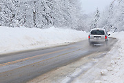 Kancamagus Scenic Byway in the White Mountains, New Hampshire USA covered in snow during the winter months.