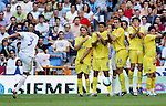 Real Madrid's Roberto Carlos takes a free kick against Villareal's Diego Forlan, Juan Roman Riquelme, Leandro Somoza, Javier Venta and Nihat Kahveci during their Spanish La Liga match against Villareal at Santiago Bernabeu Stadium in Madrid, Sunday August 27 2006. (ALTERPHOTOS/Alvaro Hernandez).