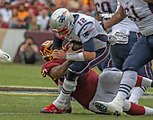 New England Patriots quarterback Tom Brady (12) is sacked by Washington Redskins defensive tackle Tim Settle (97) in the first quarter of the game at FedEx Field in Landover, Maryland on Sunday, October 6, 2019.  The Patriots won the game 33 - 7.<br /> Credit: Ron Sachs / CNP