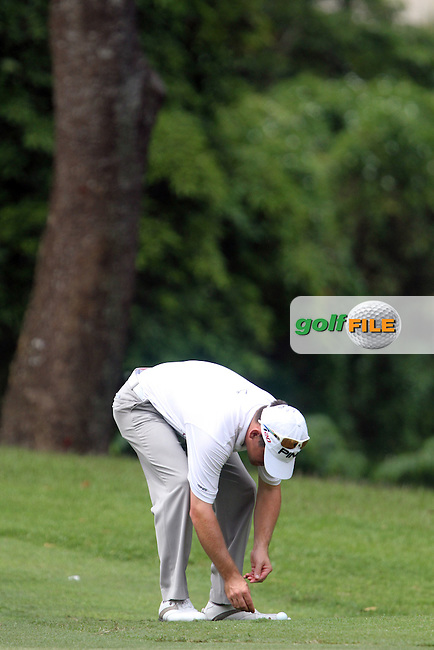 Louis Oosthuizen (RSA) marks his ball on the 3rd fairway as Play is suspended due to storm warnings  during Round 2 of the Barclays Singapore Open, Sentosa Golf Club, Singapore. 9/11/12..(Photo Jenny Matthews/www.golffile.ie)