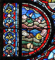 The effects of the flood, with dead bodies of the victims floating in the water, from the Life of Noah stained glass window, 13th century, in the nave of Chartres cathedral, Eure-et-Loir, France. Chartres cathedral was built 1194-1250 and is a fine example of Gothic architecture. Most of its windows date from 1205-40 although a few earlier 12th century examples are also intact. It was declared a UNESCO World Heritage Site in 1979. Picture by Manuel Cohen