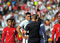 Referee Mark Geiger yellow cards New Zealand's Michael Boxall during the 2018 FIFA World Cup Russia first-leg playoff football match between the NZ All Whites and Peru at Westpac Stadium in Wellington, New Zealand on Saturday, 11 November 2017. Photo: Mike Moran / lintottphoto.co.nz