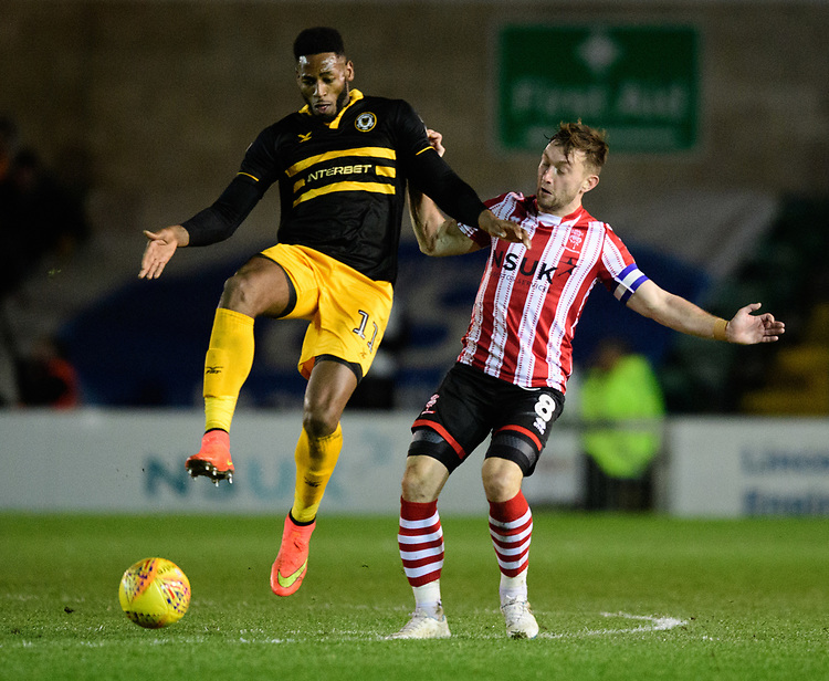 Lincoln City's Lee Frecklington vies for possession with Newport County's Jamille Matt<br /> <br /> Photographer Chris Vaughan/CameraSport<br /> <br /> The EFL Sky Bet League Two - Lincoln City v Newport County - Saturday 22nd December 201 - Sincil Bank - Lincoln<br /> <br /> World Copyright © 2018 CameraSport. All rights reserved. 43 Linden Ave. Countesthorpe. Leicester. England. LE8 5PG - Tel: +44 (0) 116 277 4147 - admin@camerasport.com - www.camerasport.com