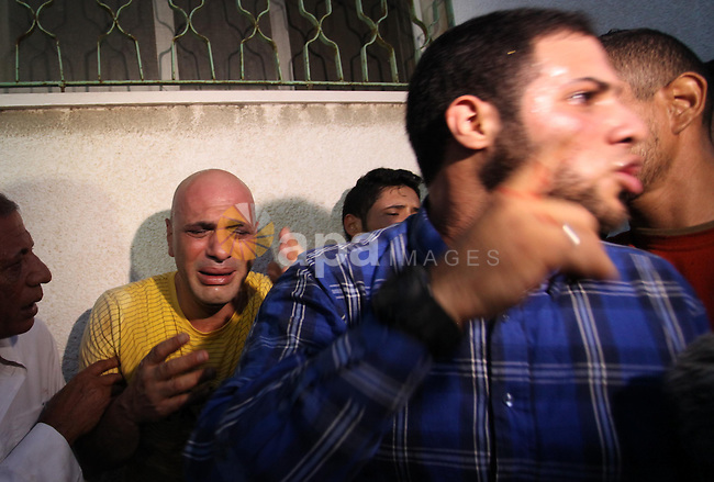 The father of 20-year-old Ziad Sharaf, who was killed during clashes with Israeli security forces near the border fence between Israel and the Gaza Strip, mourns at al-Shifa hospital in Gaza city on October 9, 2015. Tension and protests rose after an Israeli man on 09 October stabbed four Palestinians in southern Israel, in what is being seen as a revenge attack, officials said. On 08 October several violent incidents happened, including stabbings which left eight Israelis injured, one Palestinian was killed in East Jerusalem and six in the Gaza Strip in clashes with the army while at least six were injured on the West Bank. Photo by Ashraf Amra