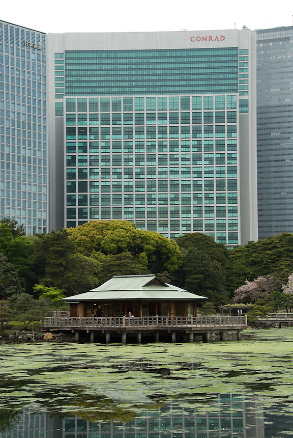 Hamarikyu Garden's Nakajima-no-chaya tea house with the Conrad hotel in the background, Tokyo, Japan.