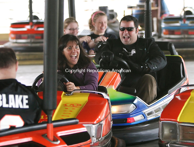 MIDDLEBURY; CT; 23 SEPTEMBER 2006; 092306BZ02- Margie Iaiennaro (CQ), of Southbury, center, gets crashed into by Food Network's &quot;Ham on the Street&quot; host George Duran, during filming for a segment at Quassy Amusement Park in Middlebury Saturday afternoon. Iaiennaro and Chris Buckley, of Woodbury, far left, carried cupcakes in different containers and crashed around in bumper cars to test the containers.<br />  Jamison C. Bazinet Republican-American