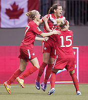 Canada players Brittany Timko, left, Christine Sinclair, center and Kelly Parker celebrate Sinclair's goal against Mexico in the CONCACAF Olympic Qualifying semifinal match at BC Place in Vancouver, B.C., Canada Friday Jan. 27, 2012. Canada won the match 3-1 to earn a berth in 2012 London Olympics.