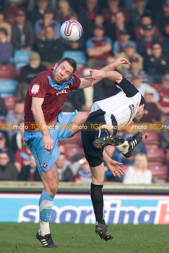 Jon Parkin (Scunthorpe Utd) goes up for the ball. - Scunthorpe United vs Notts County - nPower League One Football at Glanford Park - 24/03/12 - MANDATORY CREDIT: Mark Hodsman/TGSPHOTO - Self billing applies where appropriate - 0845 094 6026 - contact@tgsphoto.co.uk - NO UNPAID USE.