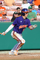 Second Baseman Steve Wilkerson #17 swings at a pitch during a  game against the Miami Hurricanes at Doug Kingsmore Stadium on March 31, 2012 in Clemson, South Carolina. The Tigers won the game 3-1. (Tony Farlow/Four Seam Images).