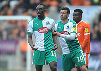 Plymouth Argyle's Freddie Ladapo (left) and Graham Carey<br /> <br /> Photographer Kevin Barnes/CameraSport<br /> <br /> The EFL Sky Bet League One - Blackpool v Plymouth Argyle - Saturday 30th March 2019 - Bloomfield Road - Blackpool<br /> <br /> World Copyright © 2019 CameraSport. All rights reserved. 43 Linden Ave. Countesthorpe. Leicester. England. LE8 5PG - Tel: +44 (0) 116 277 4147 - admin@camerasport.com - www.camerasport.com