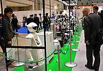 Nobember 9, 2011, Tokyo, Japan - Visitors view robots on display in the booth of New Energy and Industrial Technology Development Organization during the International Robot Exhibition 2011 opened in Tokyo on Wednesday, November 9, 2011. The three-day trade show, sponsored by the Japan Robot Association, was designed promote new products and develop new business through contributing the promotion of new technology. (Photo by Natsuki Sakai/AFLO) [3615] -mis-..