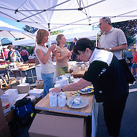 Artisan selling Goat Cheese at the Saturday Market in Ganges, Saltspring (Salt Spring) Island, Southern Gulf Islands, BC, British Columbia, Canada