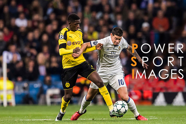 James Rodriguez of Real Madrid battles for the ball with Ousmane Dembele of Borussia Dortmund during the 2016-17 UEFA Champions League match between Real Madrid and Borussia Dortmund at the Santiago Bernabeu Stadium on 07 December 2016 in Madrid, Spain. Photo by Diego Gonzalez Souto / Power Sport Images