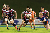 Tim Nanai-Williams makes another telling break past Finlay Christie. Mitre 10 Cup game between Counties Manukau Steelers and Tasman Mako's, played at ECOLight Stadium Pukekohe on Saturday October 14th 2017. Counties Manukau won the game 52 - 30 after trailing 22 - 19 at halftime. <br /> Photo by Richard Spranger.