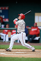 Harrisburg Senators catcher Jake Lowery (3) follows through on a swing during the second game of a doubleheader against the New Hampshire Fisher Cats on May 13, 2018 at FNB Field in Harrisburg, Pennsylvania.  Harrisburg defeated New Hampshire 2-1.  (Mike Janes/Four Seam Images)
